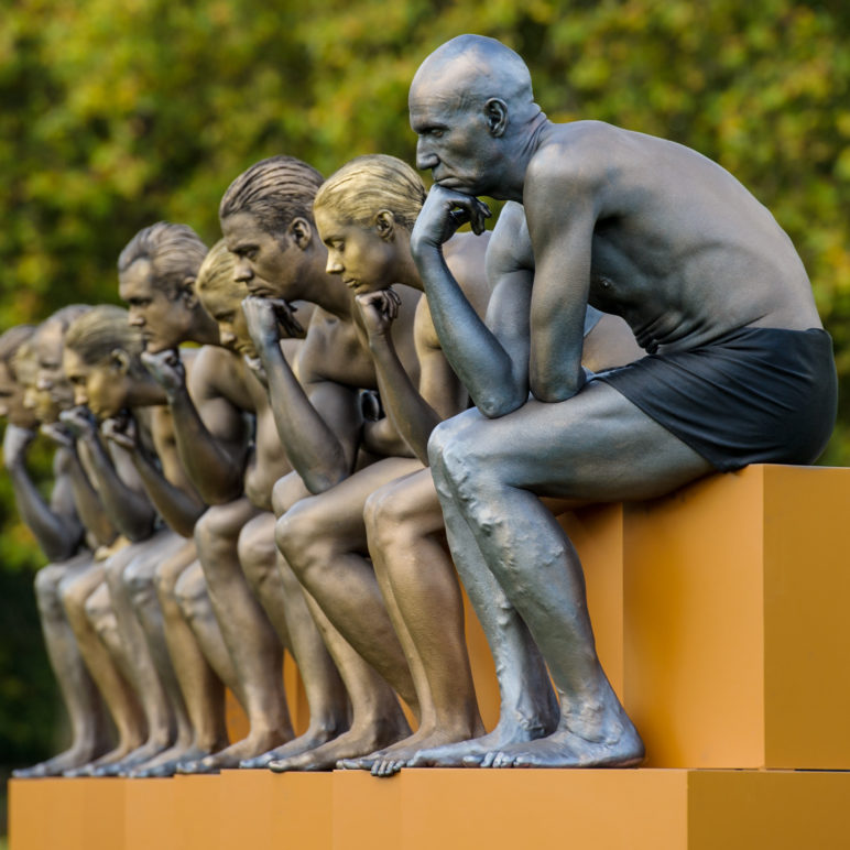 Nine models posed as Rodin's 'The Thinker' gather in Battersea Park, London, ​​to mark the launch of the Nine Dots Prize, a new prize for creative thinking​ that addresses contemporary social issues.